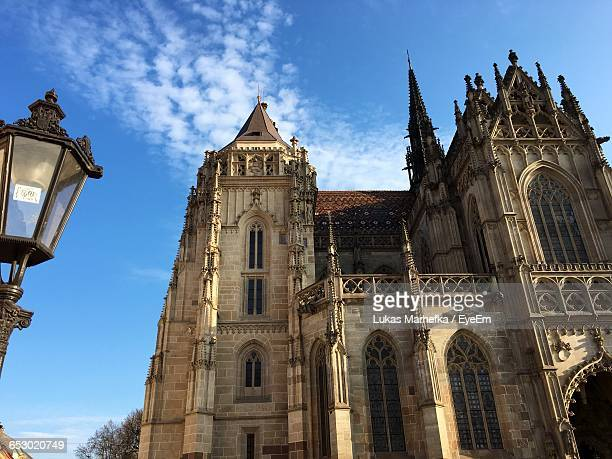 low angle view of church against blue sky - kosice stock photos and pictures