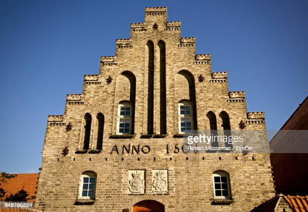 low angle view of church against blue sky - aalborg stock pictures, royalty-free photos & images