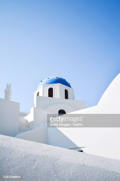 low angle view of church against clear blue sky during sunny day - santorini stock pictures, royalty-free photos & images
