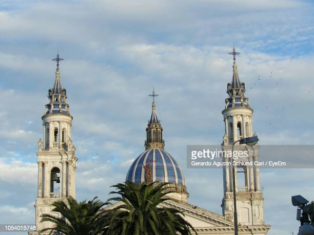 low angle view of church against cloudy sky - cari stock pictures, royalty-free photos & images