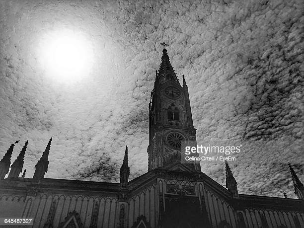 low angle view of church against cloudy sky - la plata argentina stock pictures, royalty-free photos & images