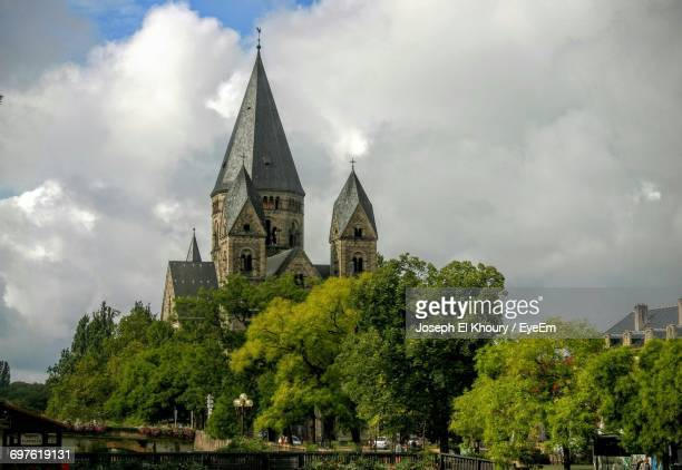 low angle view of church against cloudy sky - lorraine stock pictures, royalty-free photos & images
