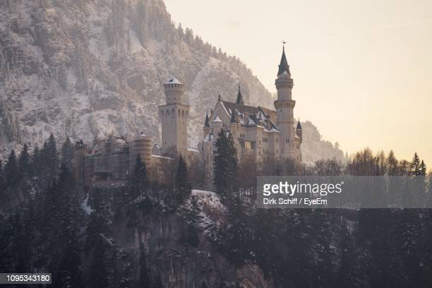 low angle view of church against mountain - schiff stock photos and pictures