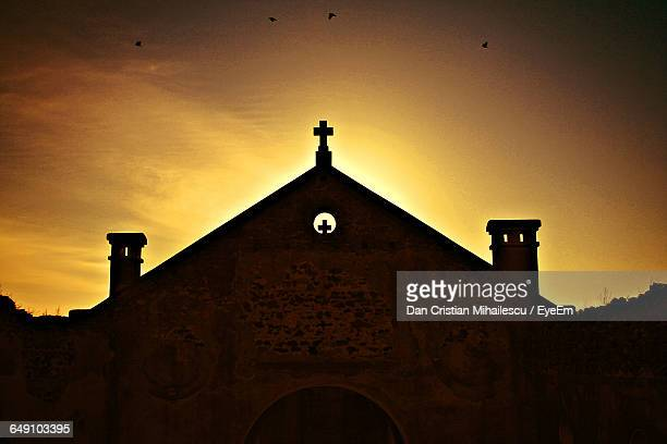 Low Angle View Of Church Against Sky During Sunset