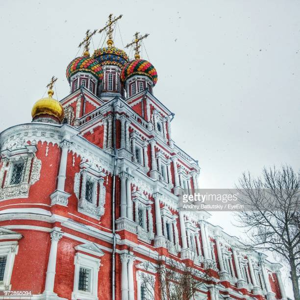 low angle view of church against sky during winter - nizhny novgorod stock pictures, royalty-free photos & images