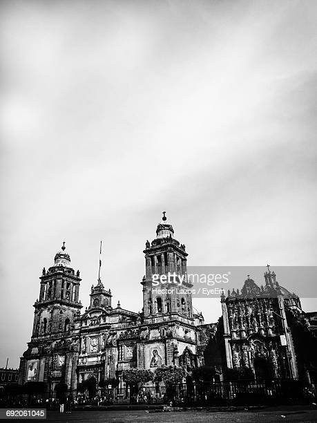 low angle view of church against sky - mexico black and white stock pictures, royalty-free photos & images