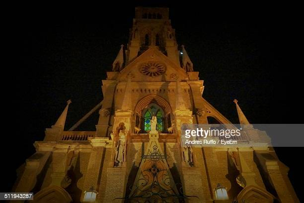 low angle view of church at night - andres ruffo bildbanksfoton och bilder