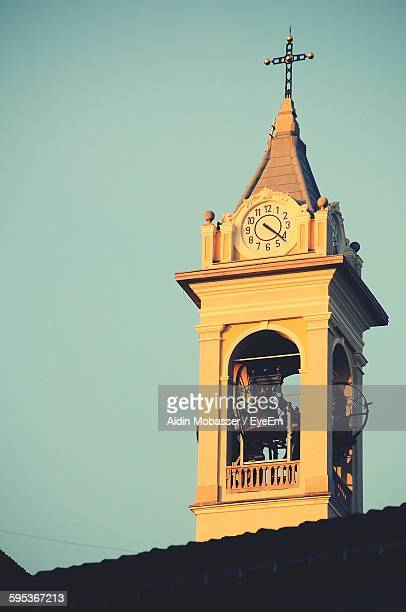 Low Angle View Of Church Bell Tower Against Clear Sky