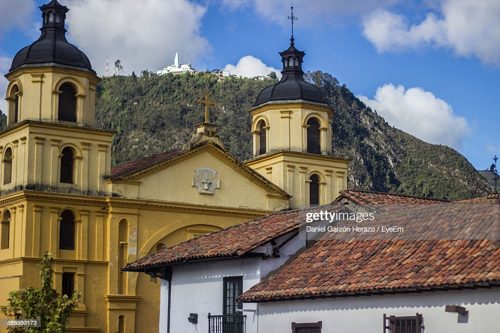Low Angle View Of Church By Mountain Against Sky : Stock Photo