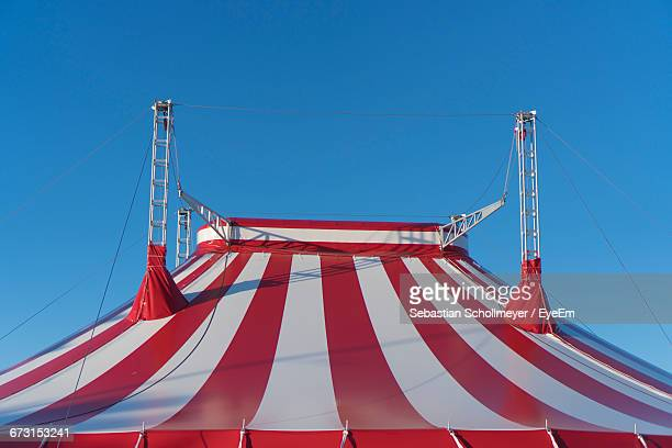 low angle view of circus tent against clear blue sky - tendone di circo foto e immagini stock