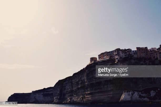 Low Angle View Of City On Beach Cliff Against Sky