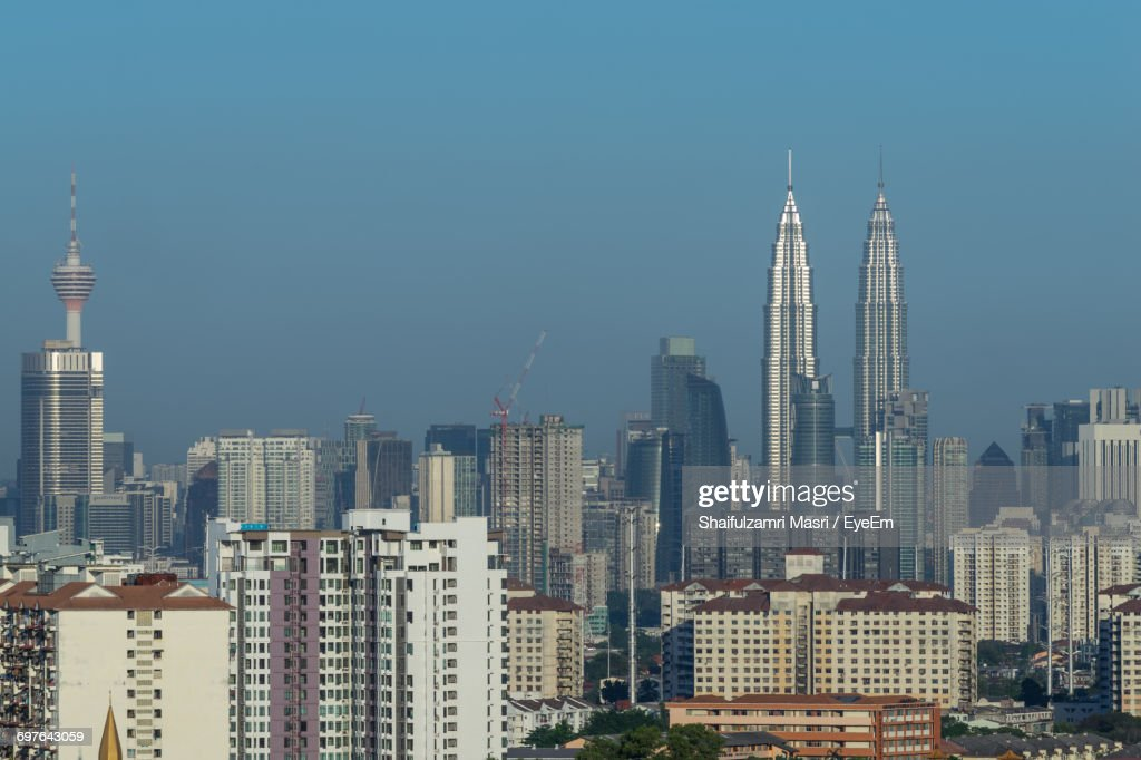 Low Angle View Of Cityscape Against Blue Sky : Photo