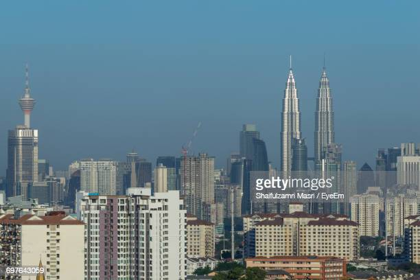 Low Angle View Of Cityscape Against Blue Sky