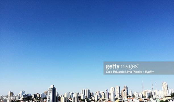 Low Angle View Of Cityscape Against Clear Blue Sky