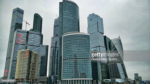 low angle view of cityscape at moscow international business center against sky - moscow international business center stock photos and pictures