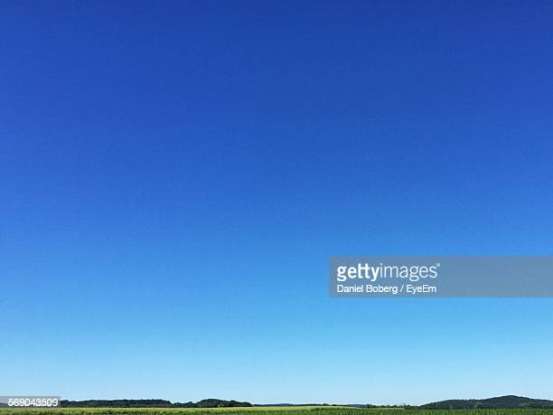 low angle view of clear blue sky - heldere lucht stockfoto's en -beelden