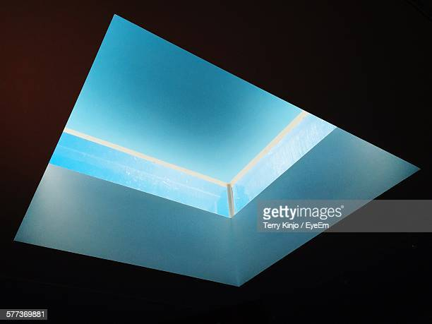 Low Angle View Of Clear Blue Sky Seen Through Skylight