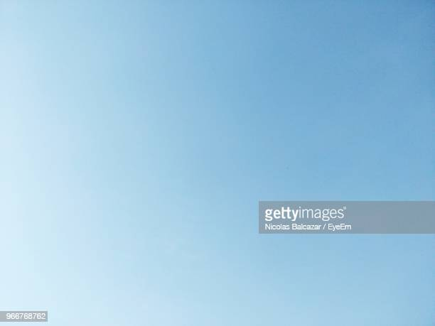 low angle view of clear sky - blau stock-fotos und bilder