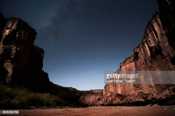 low angle view of cliff against sky at night - canyon stock pictures, royalty-free photos & images