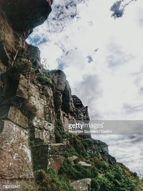 low angle view of cliff against sky - cliff saunders stock pictures, royalty-free photos & images