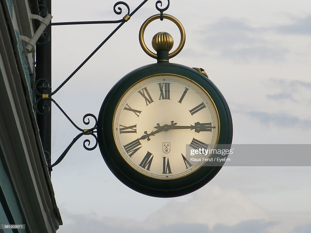Low Angle View Of Clock Against Sky : Stock Photo