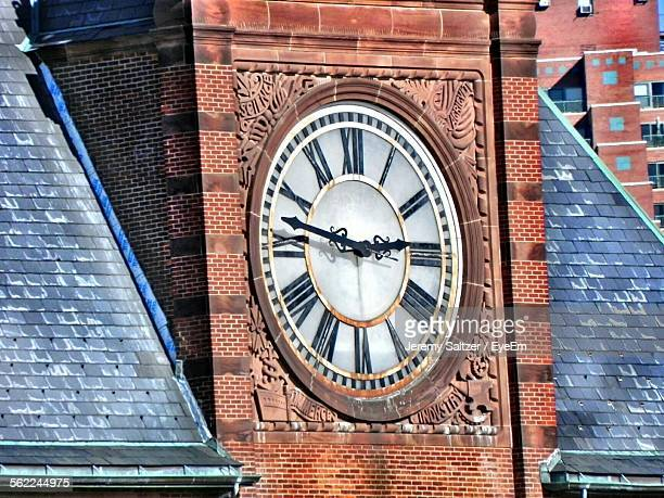 Low Angle View Of Clock Face On Building