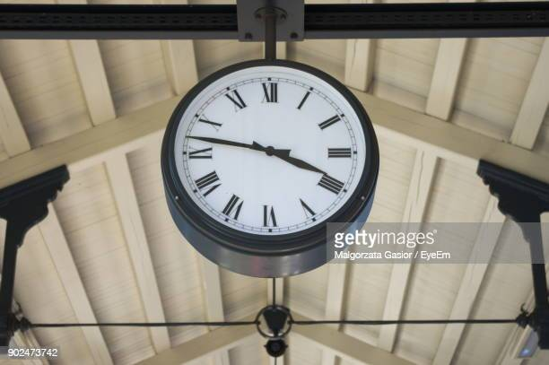 Low Angle View Of Clock Hanging From Ceiling
