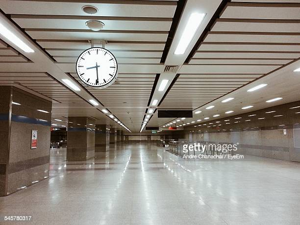 Low Angle View Of Clock In Subway Station