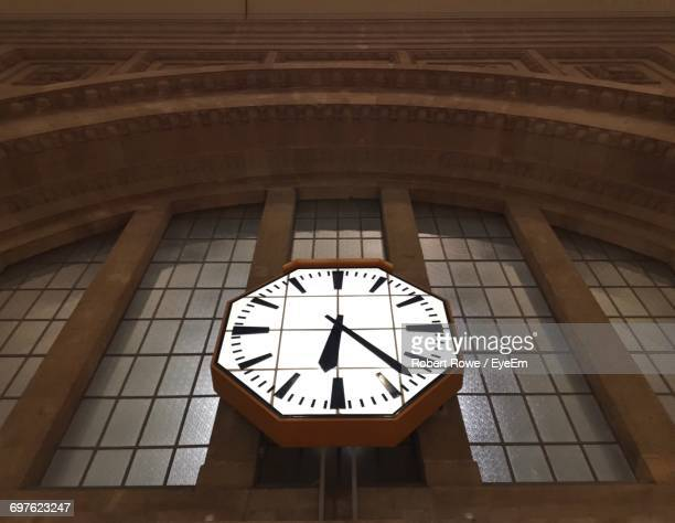 Low Angle View Of Clock On Window At Leipzig Hauptbahnhof