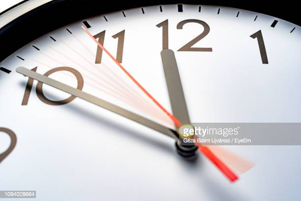 low angle view of clock - countdown stock pictures, royalty-free photos & images