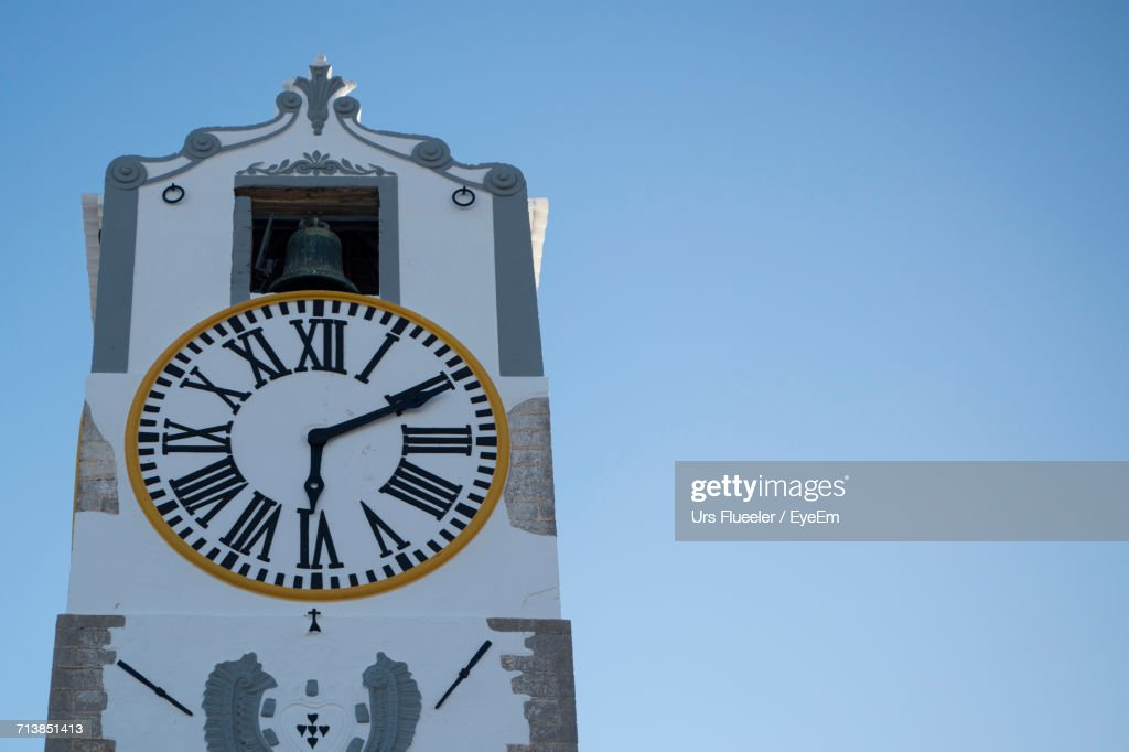 Low Angle View Of Clock Tower Against Clear Blue Sky : Stock Photo