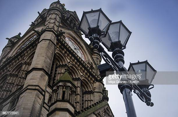 low angle view of clock tower against clear sky - manchester england photos et images de collection