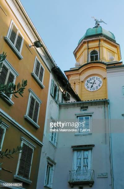 low angle view of clock tower against sky - rijeka stock pictures, royalty-free photos & images