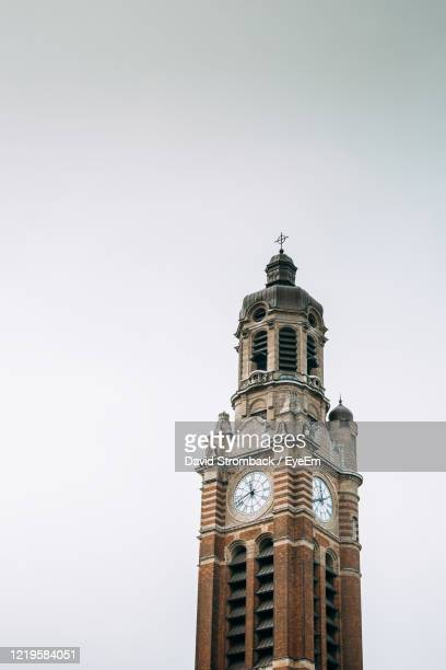 low angle view of clock tower against sky - malmo stock pictures, royalty-free photos & images