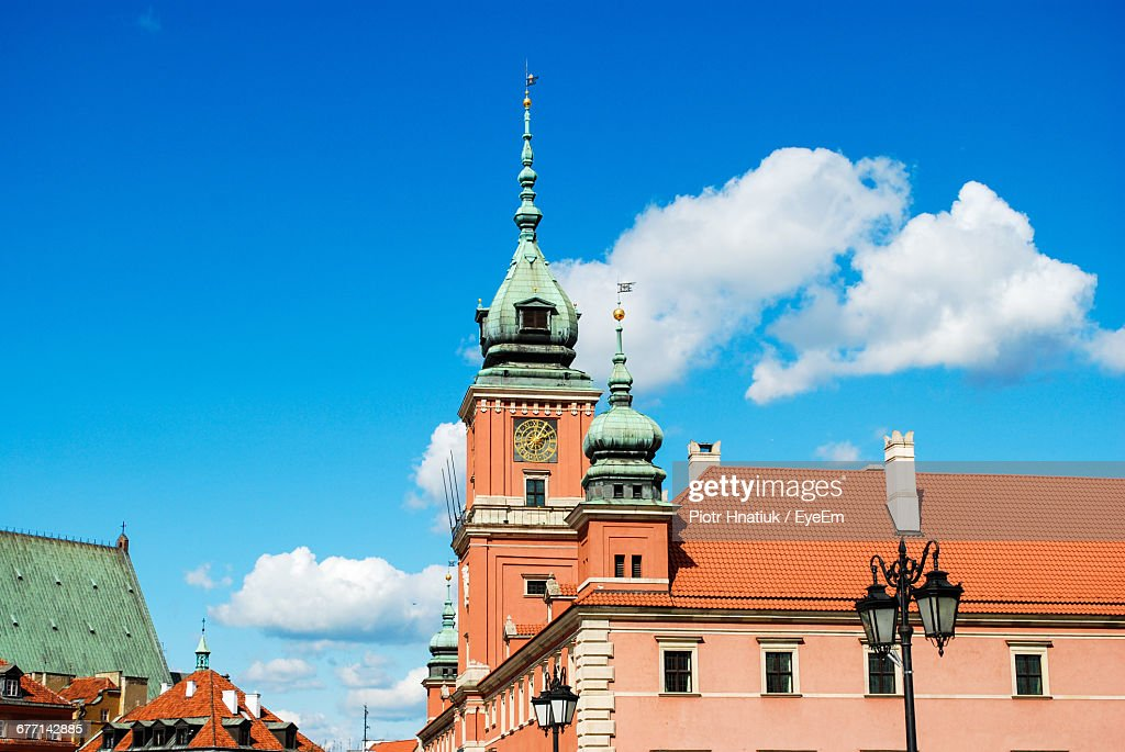 Low Angle View Of Clock Tower At Church Against Cloudy Sky : Stock Photo