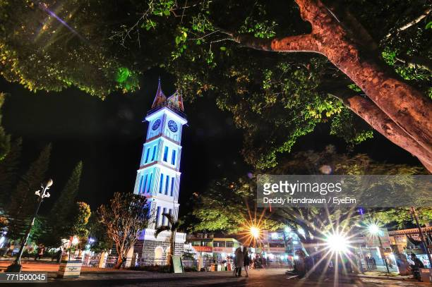Low Angle View Of Clock Tower In City At Night
