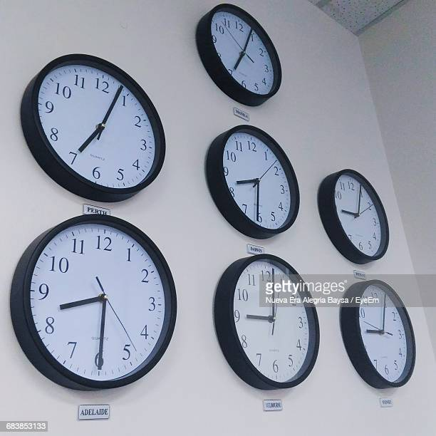 Low Angle View Of Clocks On Wall