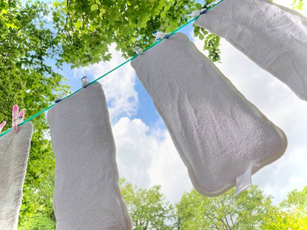 Low angle view of clothes drying on clothesline against sky,Maes Tryfan,United Kingdom,UK