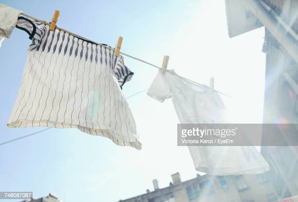 Low Angle View Of Clothesline Against Sky On Sunny Day