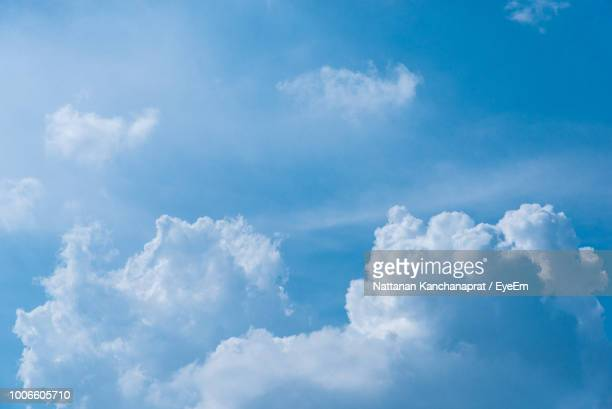 low angle view of clouds in blue sky - cloudscape stock photos and pictures