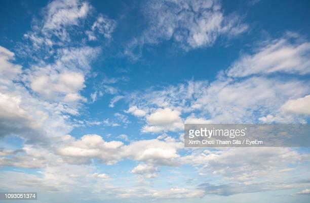 low angle view of clouds in blue sky - cloud sky stock pictures, royalty-free photos & images