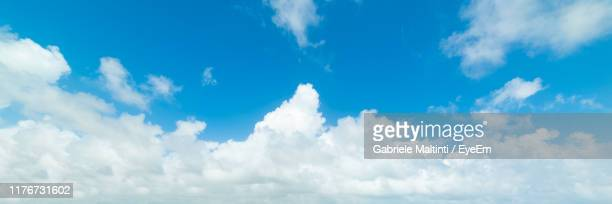 low angle view of clouds in blue sky - front view ストックフォトと画像