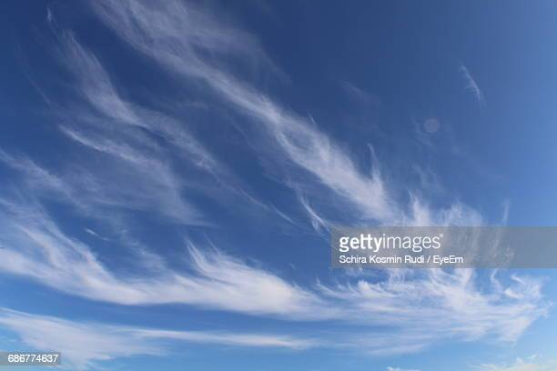 low angle view of clouds in blue sky - wispy stock photos and pictures