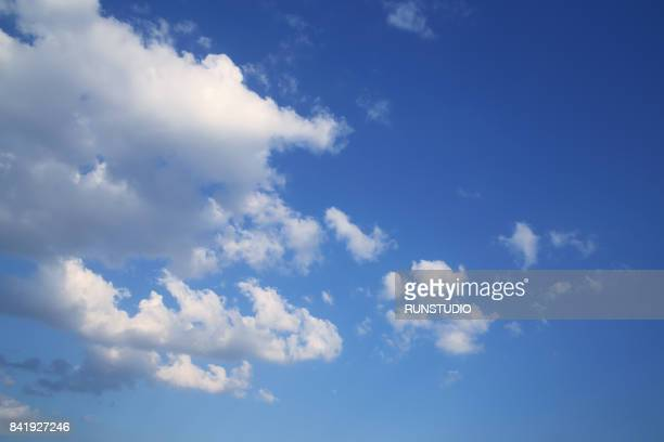 low angle view of clouds in blue sky - blue sky stock photos and pictures