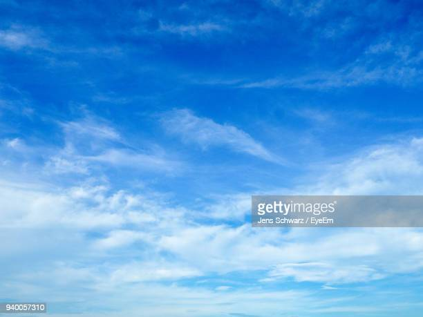 low angle view of clouds in blue sky - blue sky stock pictures, royalty-free photos & images