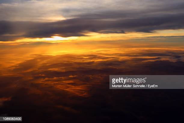 low angle view of clouds in sky during sunset - morten müller schnelle stock-fotos und bilder