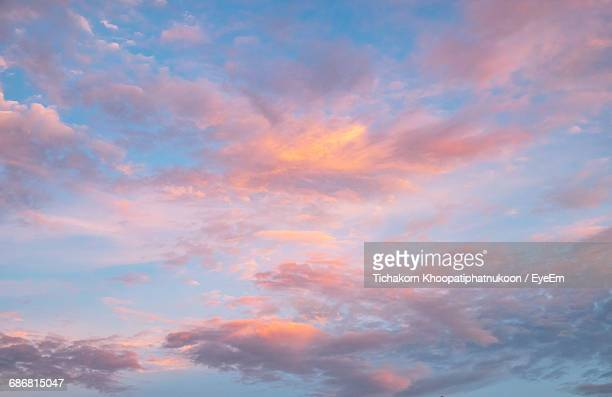low angle view of clouds in sky during sunset - cloud sky stock pictures, royalty-free photos & images
