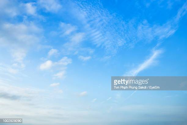 low angle view of clouds in sky - wispy stock photos and pictures