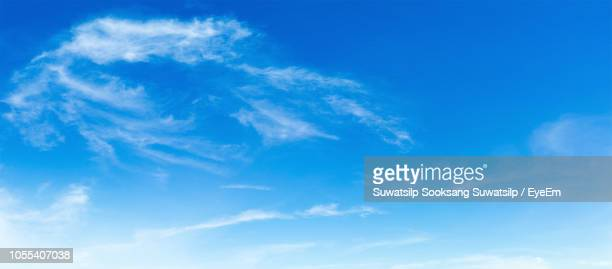 low angle view of clouds in sky - blue stock pictures, royalty-free photos & images