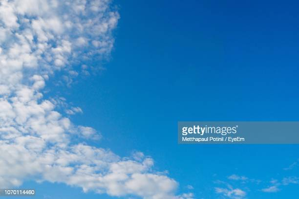 low angle view of clouds in sky - metthapaul stock photos and pictures